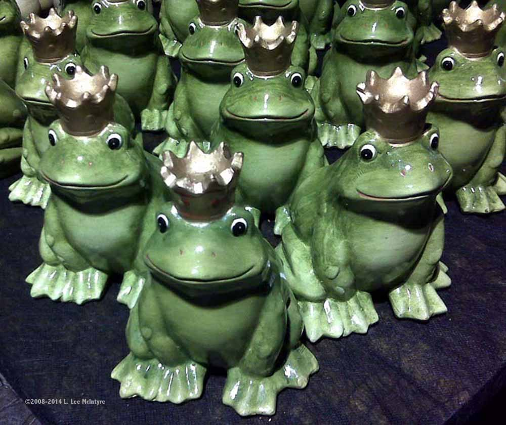 A flock of frog prince statues for sale during a festival in Piazza Walther, Bolzano